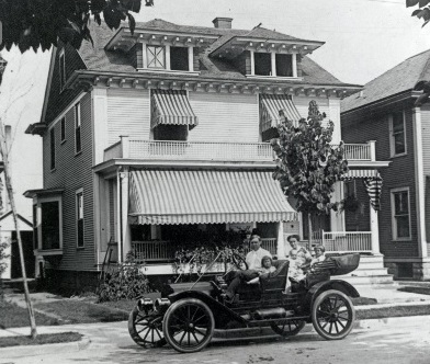 Drueke family and car in front of 120 Grand Avenue