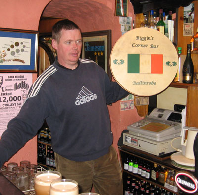 John Biggins holding Irish drum